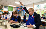 Britain's Prime Minister Boris Johnson reacts as he participates in a school art lesson to make a clay figure, at the George Spencer Academy school in Nottingham, England, during a general election campaign visit Friday Nov. 8, 2019.  Britain goes to the polls on Dec. 12 to vote in a pre-Christmas general election. (Daniel Leal-Olivas/Pool via AP)