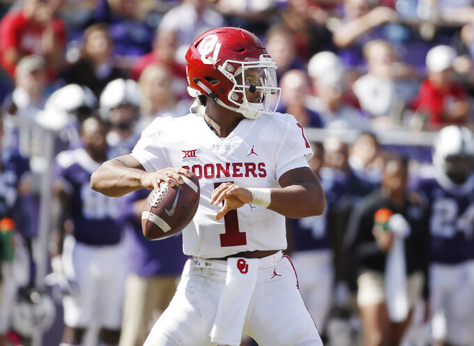 Oklahoma quarterback Kyler Murray (1) looks for an open receiver during the second half of an NCAA college football game against TCU, Saturday, Oct. 20, 2018, in Fort Worth, Texas. Oklahoma won 52-27. (AP Photo/Brandon Wade)