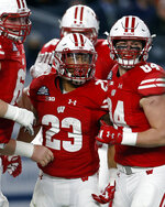 Wisconsin running back Jonathan Taylor (23) celebrates with teammates after scoring a touchdown during the first half of the Pinstripe Bowl NCAA college football game against Miami on Thursday, Dec. 27, 2018, in New York. (AP Photo/Adam Hunger)