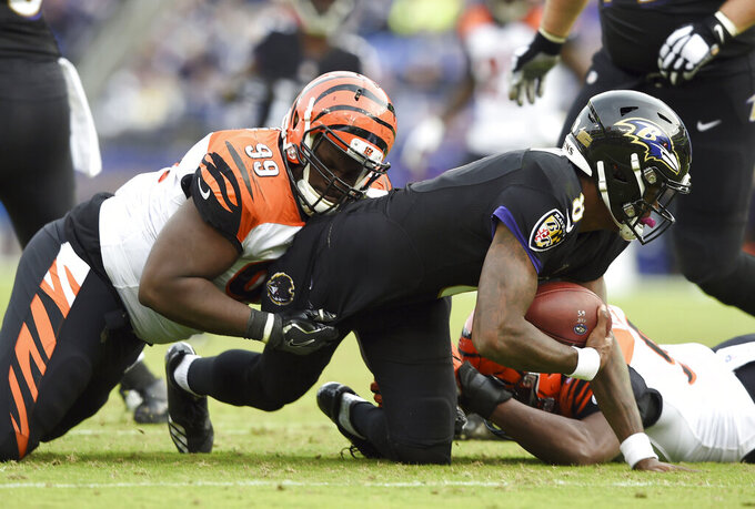 FILE - In this Sunday, Nov. 18, 2018 file photo, Cincinnati Bengals defensive tackle Andrew Billings, left, sacks Baltimore Ravens quarterback Lamar Jackson in the second half of an NFL football game in Baltimore. Cleveland added depth to its line by agreeing to a one-year deal contract with former Cincinnati Bengals tackle Andrew Billings, Thursday, March 19, 2020. (AP Photo/Gail Burton, File)