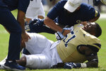 Georgia Tech defensive lineman Jahaziel Lee (51) lies injured against The Citadel during the second half of an NCAA college football game, Saturday, Sept. 14, 2019, in Atlanta. The Citadel won 27-24 in overtime. (AP Photo/Mike Stewart)