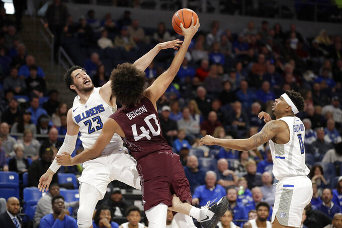 Southern Illinois' Barret Benson (40) tries to get off a shot as Saint Louis' KC Hankton (23) and Jordan Goodwin (0) defend during the first half of an NCAA college basketball game Sunday, Dec. 1, 2019, in St. Louis. (AP Photo/Jeff Roberson)