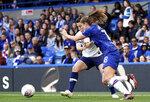 Chelsea's Maren Mjelde, right, and Tottenham Hotspur's Lucy Quinn battle for the ball during the Women's Super League soccer match at Stamford Bridge, London, Sunday Sept. 8, 2019. (John Walton/PA via AP)