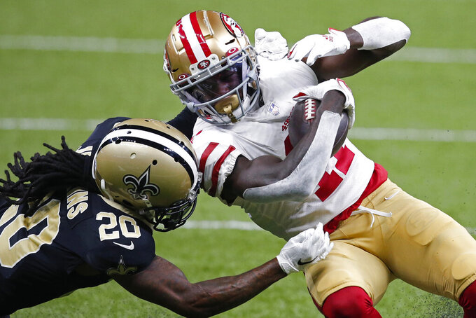 New Orleans Saints cornerback Janoris Jenkins (20) tackles San Francisco 49ers wide receiver Brandon Aiyuk (11) on a reception in the first half of an NFL football game in New Orleans, Sunday, Nov. 15, 2020. (AP Photo/Butch Dill)