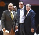 FILE - In this Nov. 6, 2015, file photo, Tennessee associate head coach Ron Lanier, left, head coach Rick Barnes, right, and assistant coach Chris Ogden, second from right, watch from the bench during an NCAA exhibition basketball game against Alabama-Huntsville, in Knoxville, Tenn. Georgia State has hired Tennessee assistant Rob Lanier to replace Ron Hunter as coach. The 50-year-old Lanier was associate head coach for the Vols the last four seasons following four years with the same title on coach Rick Barnes' staff at Texas. (Adam Lau/Knoxville News Sentinel via AP, File)