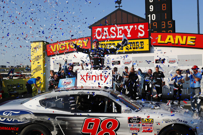 Chase Briscoe, center, celebrates after winning a NASCAR Xfinity Series auto race, Saturday, July 27, 2019, at Iowa Speedway in Newton, Iowa. (AP Photo/Matthew Putney)