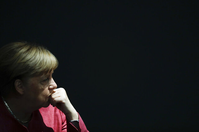 German Chancellor Angela Merkel listens to the debate about her policy as part of Germany's budget 2021 debate at the parliament Bundestag in Berlin, Germany, Wednesday, Sept. 30, 2020. (AP Photo/Markus Schreiber)