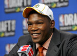 "FILE - In this June 28, 2007, file photo, Texas' Kevin Durant takes questions in the interview room after being selected by the Seattle SuperSonics as the No. 2 overall pick in the first round of the NBA Draft in New York. ""His work ethic is second to none,"" said Tennessee coach Rick Barnes, who coached Durant at Texas. (AP Photo/Jason DeCrow, File)"