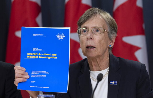 Canada's Transportation Safety chair Kathy Fox holds up a document as she speaks about the Iran plane crash during a news conference in Ottawa, Monday, January 13, 2020 (Adrian Wyld/The Canadian Press via AP)