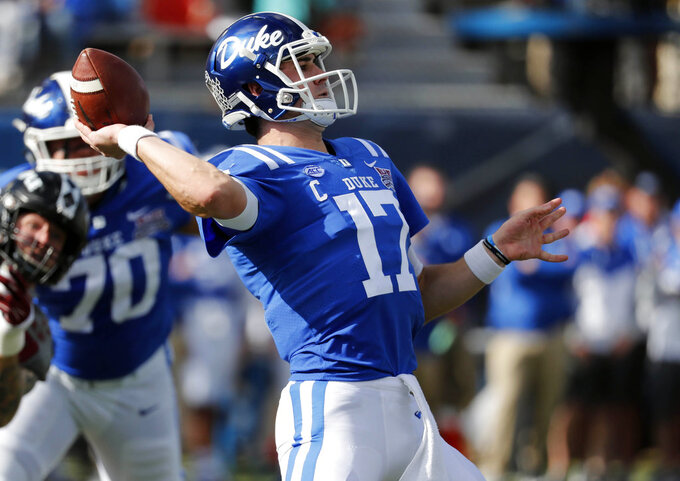 Duke quarterback Daniel Jones (17) sets to pass against Temple during the first half of the Independence Bowl, an NCAA college football game in Shreveport, La., Thursday, Dec. 27, 2018. (AP Photo/Rogelio V. Solis)