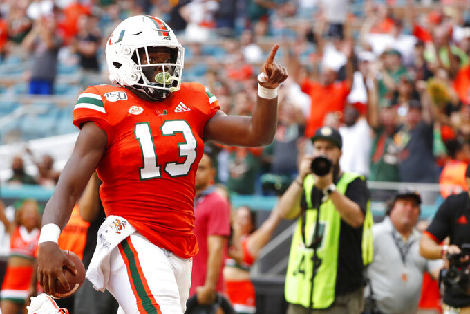 Miami running back DeeJay Dallas celebrates a touch down during the first half of an NCAA college football game against Bethune-Cookman, Saturday, Sept. 14, 2019, in Miami Gardens, Fla. (AP Photo/Wilfredo Lee)
