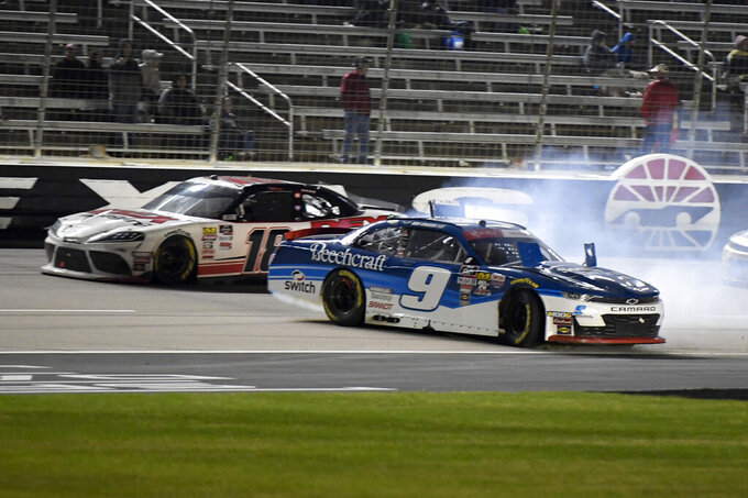 Noah Gragson (9) wrecks coming out of Turn 4 and onto the front stretch as Harrison Burton, rear, passes by during the NASCAR Xfinity Series auto race at Texas Motor Speedway in Fort Worth, Texas, Saturday, Nov. 2, 2019. (AP Photo/Larry Papke)