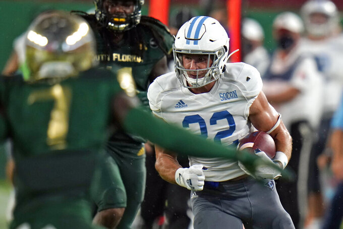 Citadel wide receiver Raleigh Webb (22) runs after a catch against South Florida during the first half of an NCAA college football game Saturday, Sept. 12, 2020, in Tampa, Fla. (AP Photo/Chris O'Meara)