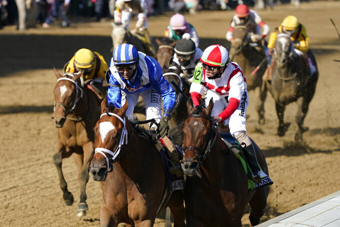 John Velazquez, left, rides Malathaat to victory during the 147th running of the Kentucky Oaks at Churchill Downs, Friday, April 30, 2021, in Louisville, Ky. (AP Photo/Jeff Roberson)