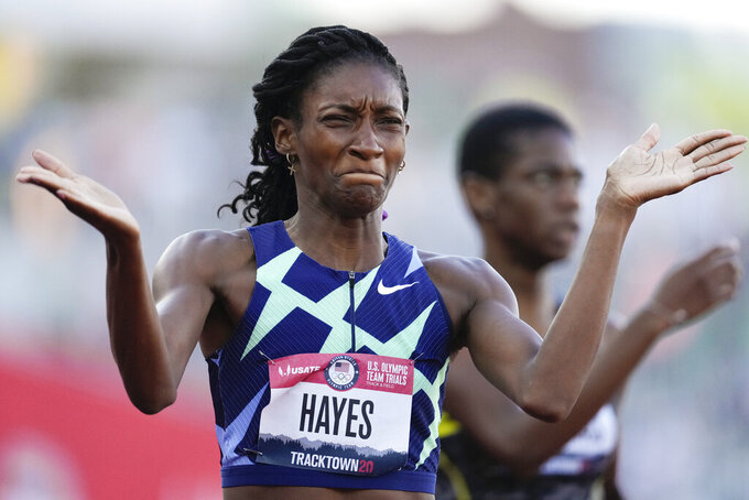 Quanera Hayes celebrates after winning the women's 400-meter run at the U.S. Olympic Track and Field Trials Sunday, June 20, 2021, in Eugene, Ore. (AP Photo/Ashley Landis)