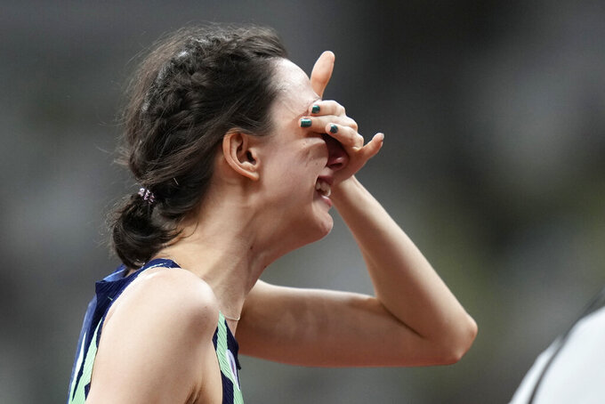 Mariya Lasitskene, of the Russian Olympic Committee, reacts after winning the women's high jump final at the 2020 Summer Olympics, Saturday, Aug. 7, 2021, in Tokyo. (AP Photo/Petr David Josek)