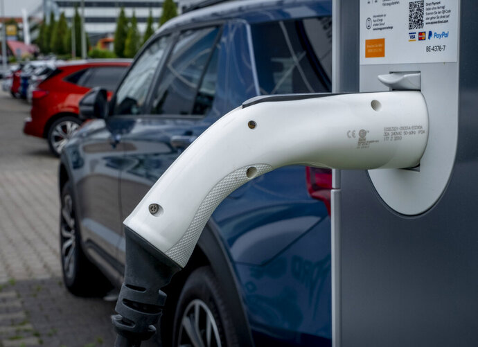 An electric car stand at a loading station of a car dealer in Bad Homburg, Germany, Thursday, Sept. 3, 2020. (AP Photo/Michael Probst)