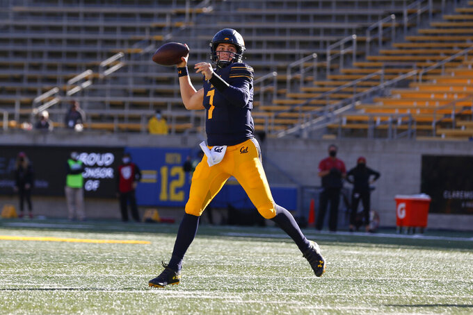 California quarterback Chase Garbers (7) throws a touchdown pass against Stanford during the first half of an NCAA college football game Friday, Nov. 27, 2020, in Berkeley, Calif. (AP Photo/Jed Jacobsohn)