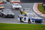 Chase Elliott leads the way out of turn 7 as he competes in a NASCAR Cup Series auto race at Charlotte Motor Speedway in Concord, N.C., Sunday, Oct. 11, 2020. Elliott won the race. (AP Photo/Nell Redmond)