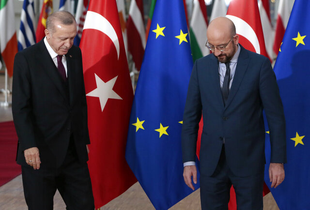 Turkish President Recep Tayyip Erdogan, left, is welcomed by European Council President Charles Michel prior to a meeting at the European Council building in Brussels, Monday, March 9, 2020. Turkish President Recep Tayyip Erdogan will visit Brussels on Monday for talks with European Union officials amid a standoff between Ankara and Brussels over sharing of responsibility for refugees and migrants. (AP Photo/Virginia Mayo)