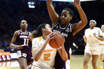 Tennessee's Rae Burrell (12) looks for the open shot while guarded by Texas A&M center Ciera Johnson during an NCAA college basketball game in Knoxville, Tenn., Sunday, Feb. 16, 2020. (Saul Young/Knoxville News Sentinel via AP)