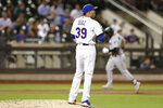New York Mets relief pitcher Edwin Diaz (39) looks away as Miami Marlins' Austin Dean rounds the bases, back right, after hitting a solo home run during the ninth inning of a baseball game, Thursday, Sept. 26, 2019, in New York. (AP Photo/Kathy Willens)