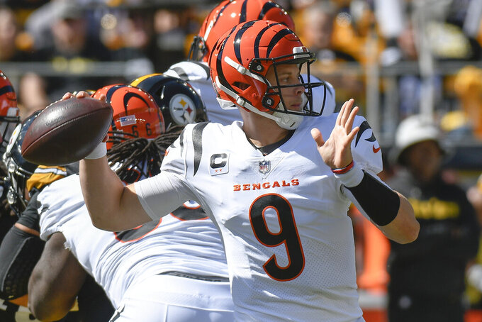 Cincinnati Bengals quarterback Joe Burrow (9) passes against the Pittsburgh Steelers during the first half an NFL football game, Sunday, Sept. 26, 2021, in Pittsburgh. (AP Photo/Don Wright)