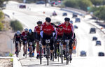 Cyclists climb a steep hill during El Tour de Tucson in Tucson, Ariz., on Nov. 23, 2019. The El Tour De Tucson cycling event has been postponed from November 2020 to April 2021. Fallout from the coronavirus pandemic has dealt a punishing blow to the southern Arizona city where dozens of winter and spring events normally attract crowds big and small (Josh Galemore/Arizona Daily Star via AP)