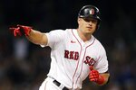 Boston Red Sox's Hunter Renfroe runs on his three-run home run during the fourth inning of a baseball game against the Minnesota Twins, Tuesday, Aug. 24, 2021, in Boston. (AP Photo/Michael Dwyer)