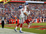 New York Giants quarterback Daniel Jones (8) celebrates his touchdown run against the Tampa Bay Buccaneers with wide receiver Darius Slayton (86) during the second half of an NFL football game Sunday, Sept. 22, 2019, in Tampa, Fla. (AP Photo/Mark LoMoglio)