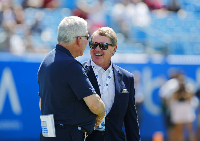North Carolina head coach Mack Brown, left, talks to ACC commissioner John Swofford prior to an NCAA college football game against South Carolina in Charlotte, N.C., Saturday, Aug. 31, 2019. (AP Photo/Nell Redmond)