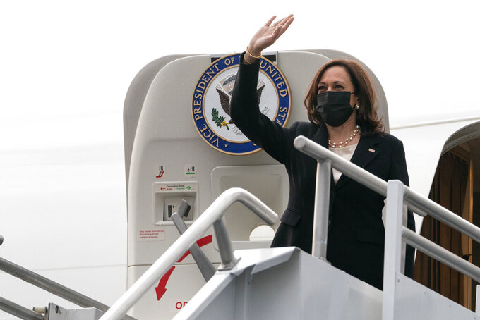 Vice President Kamala Harris boards Air Force Two, Tuesday, June 8, 2021, as she leaves Mexico City, on expected return to Washington after her first international trip as Vice President, with stops in Guatemala and Mexico City. (AP Photo/Jacquelyn Martin)