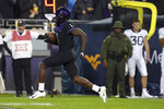 TCU wide receiver Jalen Reagor (1) returns a punt for a touchdown against West Virginia in the third quarter of an NCAA college football game Friday, Nov. 29, 2019, in Fort Worth, Texas. (AP Photo/Richard W. Rodriguez)