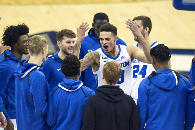 Creighton's Christian Bishop pumps up his team before they take on Kennesaw State in an NCAA college basketball game in Omaha, Neb., Friday, Dec. 4, 2020. (AP Photo/Kayla Wolf)