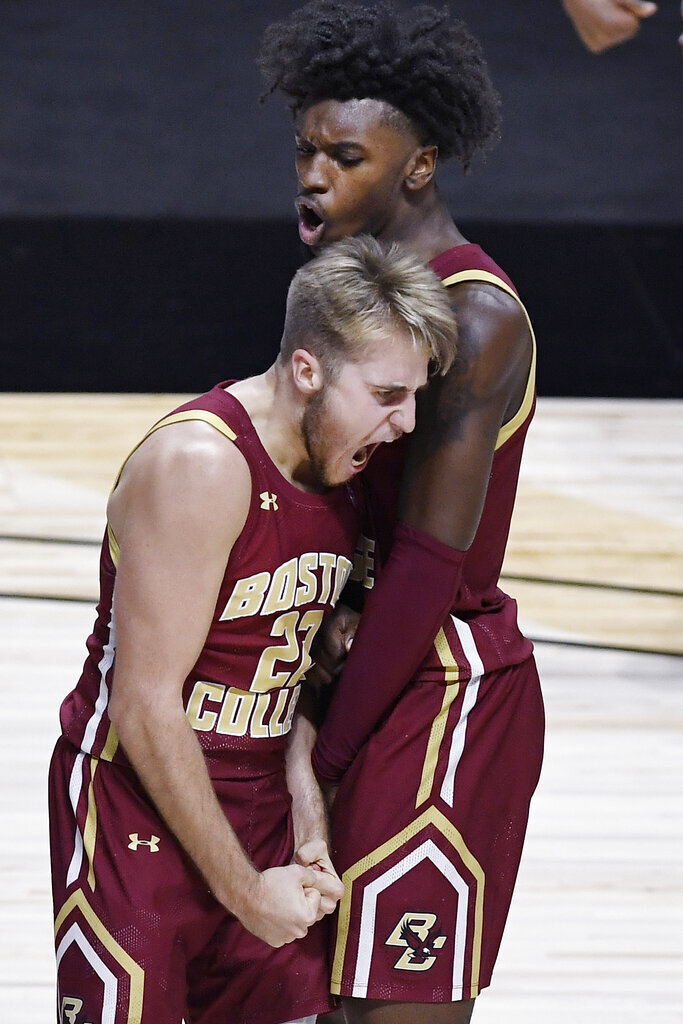 Boston College's Rich Kelly, left, and CJ Felder celebrate during the second half of the team's NCAA college basketball game against Rhode Island, Thursday, Nov. 26, 2020, in Uncasville, Conn. (AP Photo/Jessica Hill)