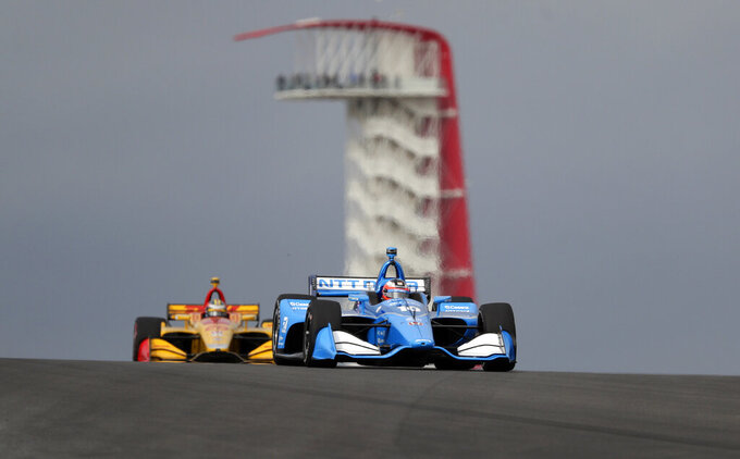 Felix Rosenqvist (10), of Sweden, and Ryan Hunter-Reay (28), of United States, steer through a turn during an open practice session for the IndyCar Classic auto race, Saturday, March 23, 2019, in Austin, Texas. (AP Photo/Eric Gay)