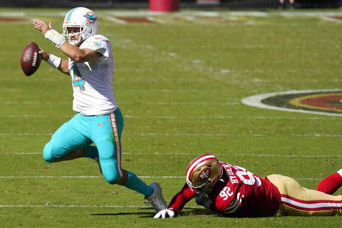 San Francisco 49ers defensive end Kerry Hyder Jr. (92) sacks Miami Dolphins quarterback Ryan Fitzpatrick (14) during the first half of an NFL football game in Santa Clara, Calif., Sunday, Oct. 11, 2020. (AP Photo/Tony Avelar)