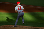 Sun light falls across the infield as Los Angeles Angels starting pitcher Patrick Sandoval winds up to deliver to the Texas Rangers in the fourth inning of a baseball game in Arlington, Texas, Saturday, Aug. 8, 2020. (AP Photo/Tony Gutierrez)