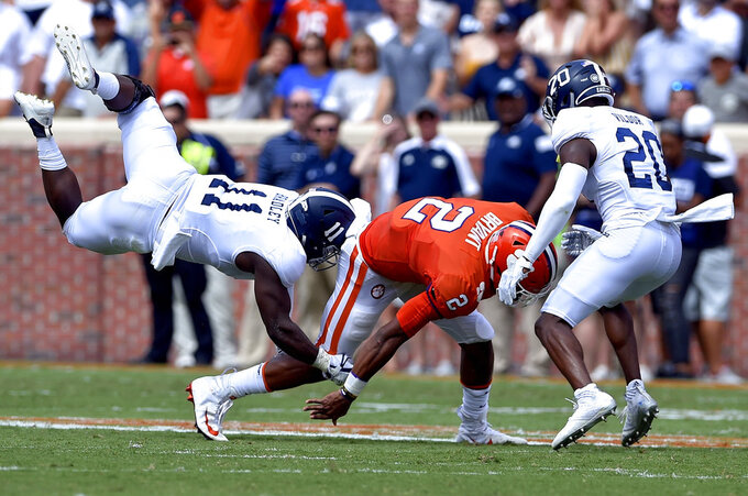 Clemson quarterback Kelly Bryant (2) is tackled by Georgia Southern's Todd Bradley, (11) and Kindle Vildor during the first half of an NCAA college football game Saturday, Sept. 15, 2018, in Clemson, S.C. (AP Photo/Richard Shiro)