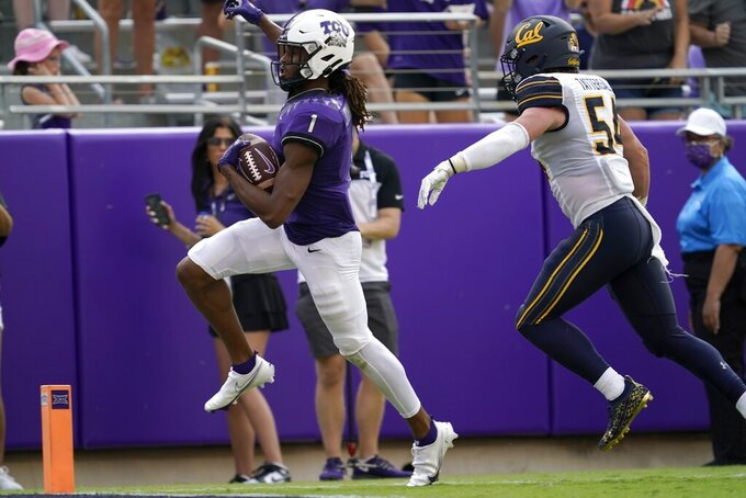 TCU wide receiver Quentin Johnston (1) sprints past California linebacker Evan Tattersall (54) into the end zone for a touchdown after catching a pass in the second half of an NCAA college football game in Fort Worth, Texas, Saturday, Sept. 11, 2021. (AP Photo/Tony Gutierrez)