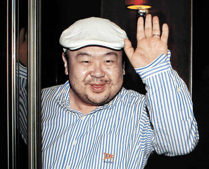 FILE - In this June 4, 2010, file photo, Kim Jong Nam, the eldest son of then North Korean leader Kim Jong Il, waves after his first-ever interview with South Korean media in Macau. The murder of North Korean leader Kim Jong Un's estranged half-brother at an airport in Malaysia was brazen, intricately orchestrated and, thanks to scores of security cameras, witnessed by millions around the world. The real masterminds behind the killing, however, may never be brought to justice. (Shin In-seop/JoongAng Ilbo via AP, File)