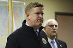 Brendan Kelly Director of Illinois State Police, left, confirms the death of retired state police trooper Gregory Rieves,  during a news conference at the DuPage Coroner's office in Wheaton, Ill., Saturday Jan. 25, 2020.  A woman fatally shot the retired Illinois State Police trooper and wounded another retired state trooper and an off-duty trooper Friday night before turning the gun on herself at a cigar lounge in the Chicago suburbs, police said.  (Abel Uribe/Chicago Tribune via AP)