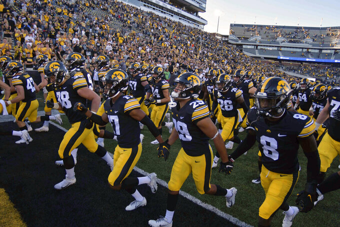 Iowa players leave the field after their 24-14 win over the Colorado State in an NCAA college football game, Saturday, Sept. 25, 2021, in Iowa City, Iowa. (AP Photo/Ron Johnson)