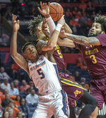 Illinois guard Tevian Jones, left, and Minnesota guard Amir Coffey and forward Jordan Murphy (3) go after a rebound during the first half of an NCAA college basketball game in Champaign, Ill., Wednesday, Jan. 16, 2019. (AP Photo/Rick Danzl)