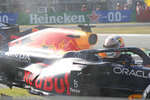 Red Bull driver Max Verstappen of the Netherlands looks out after crashing with Mercedes driver Lewis Hamilton of Britain during the Italian Formula One Grand Prix, at Monza racetrack, in Monza, Italy, Sunday, Sept.12, 2021. (AP Photo/Luca Bruno)