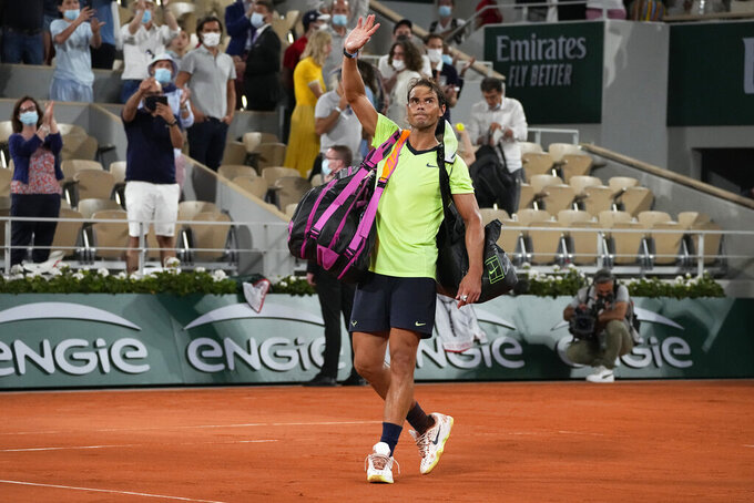 Spain's Rafael Nadal waves after losing to Serbia's Novak Djokovic in their semifinal match of the French Open tennis tournament at the Roland Garros stadium Friday, June 11, 2021 in Paris. Novak Djokovic won 3-6, 6-3, 7-6 (4), 6-2. (AP Photo/Michel Euler)
