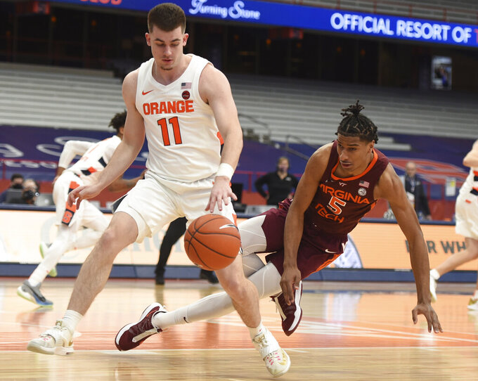 Syracuse guard Joseph Girard III (11) changes direction against Virginia Tech forward David N'Guessan (5) during an NCAA college basketball game at the Carrier Dome, Syracuse, N.Y., Saturday Jan. 23, 2021. (Scott Schild/The Post-Standard via AP)