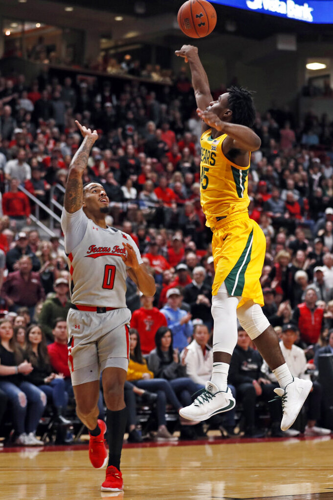Baylor's Davion Mitchell (45) blocks the pass by Texas Tech's Kyler Edwards (0) during the first half of an NCAA college basketball game Tuesday, Jan. 7, 2020, in Lubbock, Texas. (AP Photo/Brad Tollefson)