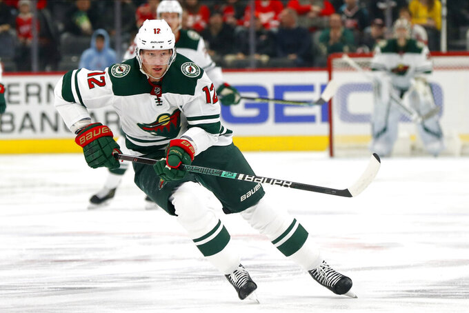 FILE - In this Feb. 27, 2020, file photo, Minnesota Wild center Eric Staal (12) skates against the Detroit Red Wings in the first period of an NHL hockey game in Detroit. Buffalo Sabres coach Ralph Krueger prefers viewing the start of the 2021 shortened season as a continuation of the last one. If that's the case, the new-look Sabres, with the addition of Taylor Hall and Eric Staal, have plenty of unfinished business in attempting to snap a nine-year playoff drought, the NHL's longest active streak. (AP Photo/Paul Sancya, File)