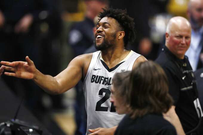 Colorado Buffaloes forward Evan Battey celebrates with fans after the second half of an NCAA college basketball game against USC Saturday, March 9, 2019, in Boulder, Colo. Colorado won 78-67. (AP Photo/David Zalubowski)